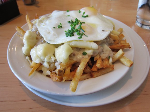 Brunch Style Poutine - Fried egg, Amish cheese curds, Parma sausage gravy
